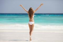 Bronze Tan Woman Sunbathing At Tropical Beach Stock Photos