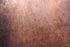 Copper or brass background, texture of non-ferrous metal. Bronze texture, color stripped metal sheet gloss Stock Photography