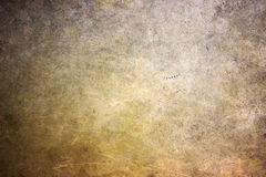 Bronze texture, golden hue metal surface as a background Royalty Free Stock Images