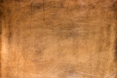 Old metal plate, brushed texture copper, bronze background. Bronze texture, metal plate as background or element for design stock photography