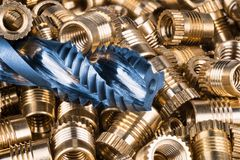 Free Bronze Thread Inserts And Spiral Flute Tap Stock Image - 112898641