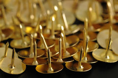 Bronze thumb tacks Royalty Free Stock Photography