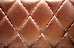 Bronze upholstery leather background Royalty Free Stock Photography