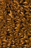 Bronze verlässt Hintergrund Lizenzfreie Stockbilder
