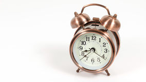 bronze vintage alarm clock isolated on white background with cop Royalty Free Stock Images