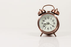 bronze vintage alarm clock isolated on white background with cop Stock Images