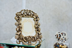 Bronze vintage frame of decor at wedding reception. Royalty Free Stock Image
