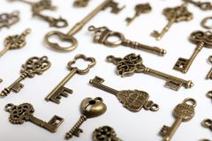 Bronze vintage ornate keys. On white background royalty free stock photos