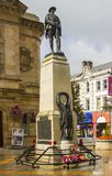 The bronze war memorial of a British Tommy to honour the dead of the 1st and 2nd world wars in the town centre of Coleraine. On the north coast of Northern Royalty Free Stock Photography