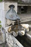 Bronze water fountain in form of a plaice flat fish Stock Photography