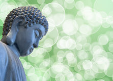 Bronze Zen Buddha Statue Meditating. With Blurred Background Stock Images