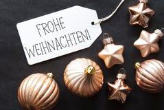 Bronzebaum-Bälle, Frohe Weihnachten bedeutet frohe Weihnachten Stockfotografie