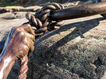 Bronzed hand and rope Stock Photography