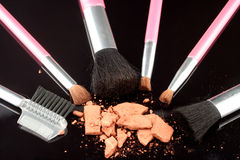 Bronzer and brushes royalty free stock image