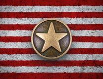 Bronzestern auf US-Flaggenhintergrund Stockbild