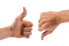 Bronzevoting: um polegar acima, um para baixo Fotografia de Stock Royalty Free