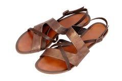 Bronzfärgade sandaler för strandläder Arkivbilder