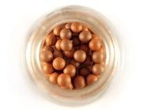 Bronzing pearls. Closeup box of bronzing pearls over white Stock Image