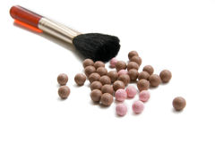 Bronzing pearls and brush Royalty Free Stock Photos