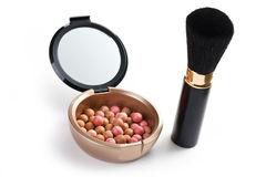 Bronzing pearls and makeup brush Royalty Free Stock Photos