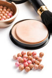 Bronzing pearls and makeup brush Royalty Free Stock Photo
