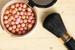 Bronzing pearls and makeup brush Royalty Free Stock Photography
