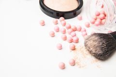 The bronzing pearls and makeup brush Royalty Free Stock Photo