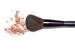 Bronzing powder with makeup brush on white background Royalty Free Stock Images