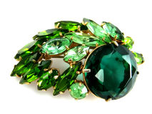 Brooch. Shiny emerald brooch isolated on white stock photography
