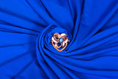Brooch on blue Stock Image