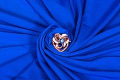 Brooch on blue Stock Image