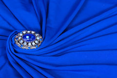 Brooch on blue Stock Photo