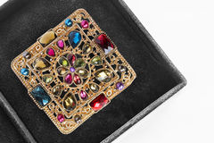 Brooch in a box Royalty Free Stock Images