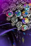 Brooch with brilliant stones. On violet fabric Royalty Free Stock Photos