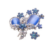 Brooch with different gems on background. Royalty Free Stock Images