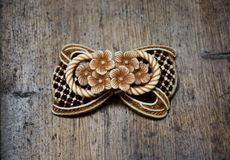Brooch with flowers. Cute brown brooch with flowers Royalty Free Stock Image