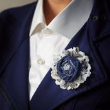 Brooch handmade in the form of a flower from denim as additional accessory of a woman business suit stock images