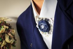 Brooch handmade in the form of a flower from denim as a supplement of a woman business suit royalty free stock image