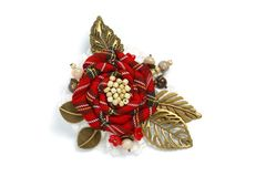 Brooch handmade in the form of a large flower of checkered fabric and metal leaves on a white background Stock Photos