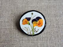 Handmade brooch from dried pressed pansy flowers Royalty Free Stock Photo