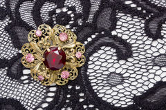 Brooch round shape with large red rocks Stock Photos