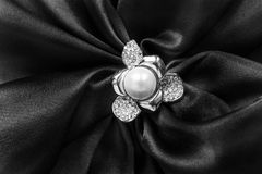 Brooch on satin Royalty Free Stock Photography
