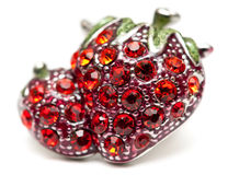 Brooch in the shape of strawberries Stock Photos