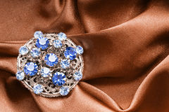 Brooch on silk Royalty Free Stock Images