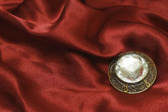 Brooch with zircon on red silk Royalty Free Stock Photo