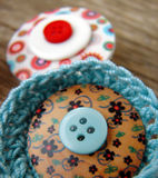 Brooches with buttons. On old wooden table Stock Photo