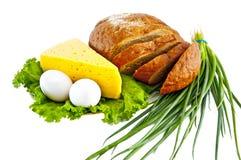 Brood, eieren, kaas, groene uien en salade Royalty-vrije Stock Foto