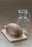 Brood en water Royalty-vrije Stock Afbeelding