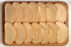 Brood op een raad Stock Fotografie