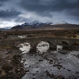 Brooding sky over stone Sligachan Bridge, river Sligachan, Isle of Skye stock photography